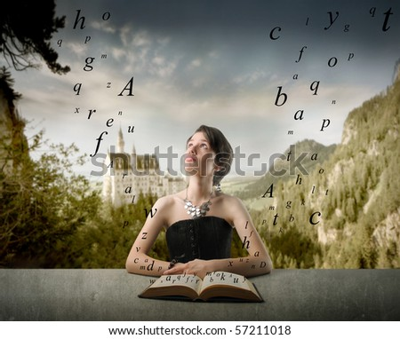 Woman wondering about something while reading a book with castle on the background - stock photo
