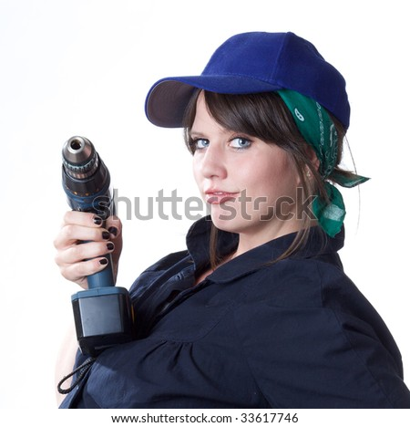 Woman worker holding a battery powered electric drill; isolated on a white background. - stock photo