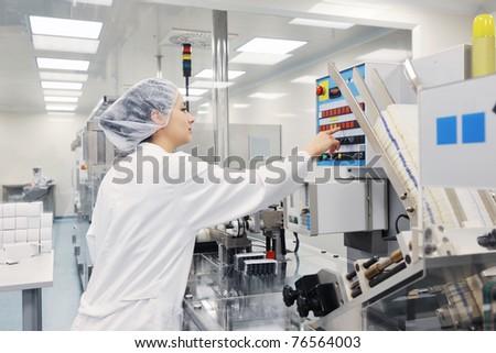 woman worker in pharmacy company warehouse - stock photo