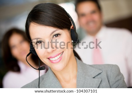 Woman working at a call center and wearing headset - stock photo