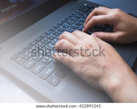 Woman working at home office  hand on computer keyboard