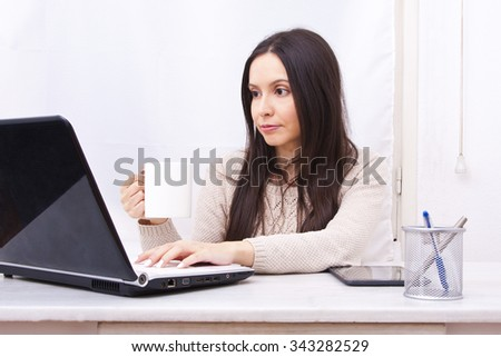 woman working at home online