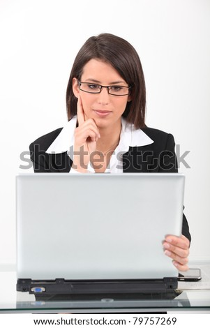 Woman working at laptop - stock photo