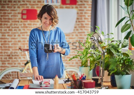 Woman Working at modern start up home office - stock photo