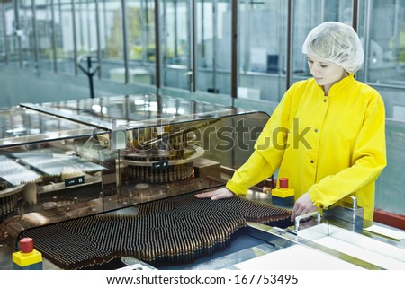 Woman working at the pharmaceutical factory. Shallow DOFF. See more images and video from this series.  - stock photo