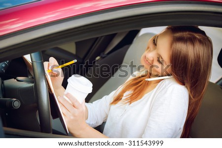 Woman working at the wheel in the car.