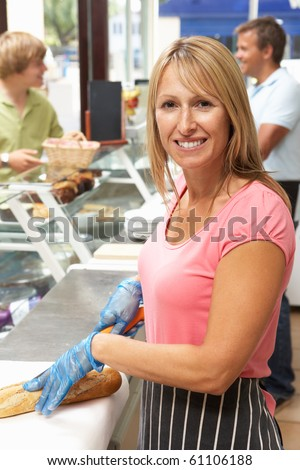 Woman Working Behind Counter In Cafe - stock photo