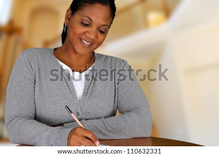 Woman working from home in her living room - stock photo