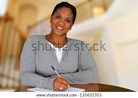 Woman working from home in her living room