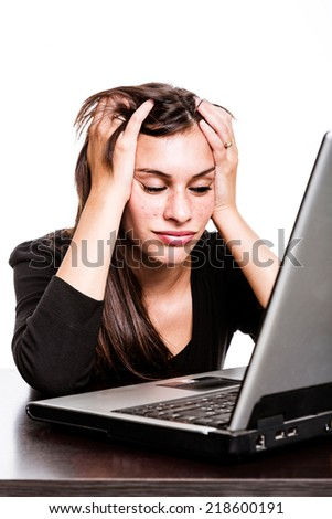 Woman working hard on laptop. Frustration.