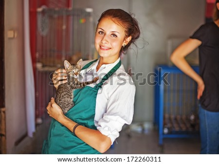 woman working in animal shelter - stock photo