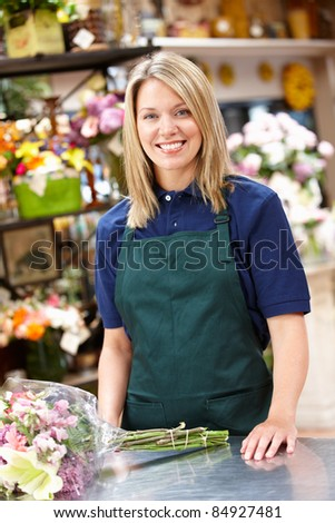 Woman working in florist - stock photo