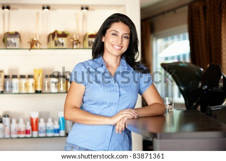 Woman working in hairdressing salon - stock photo