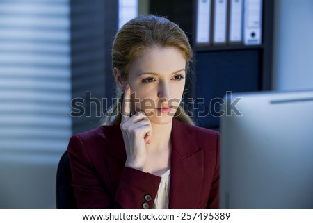 Woman working in the office - stock photo