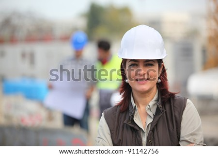 Woman working on a construction site - stock photo