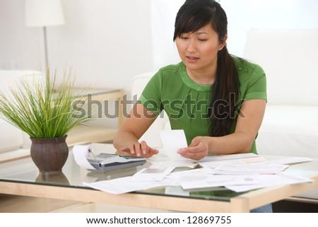 Woman working on finances - stock photo