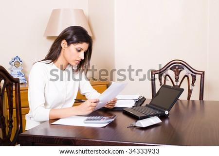 woman working on her bills - stock photo