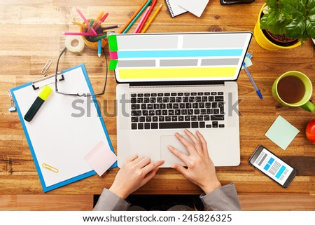 Woman working on laptop. Concept of web design. Shot from above view - stock photo