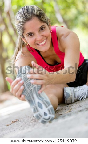 Woman working out at the park looking very happy - stock photo