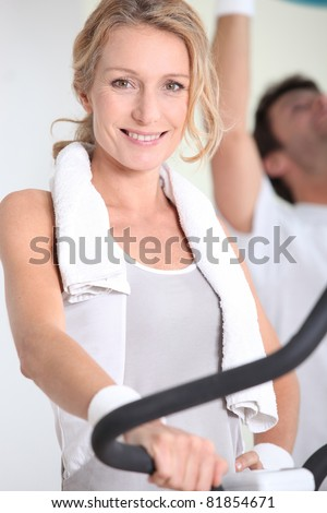 Woman working out in a gym - stock photo
