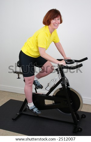 Woman working out indoors on a  bike