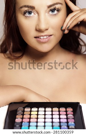 woman working out whats the best colour to pick for her skin. - stock photo
