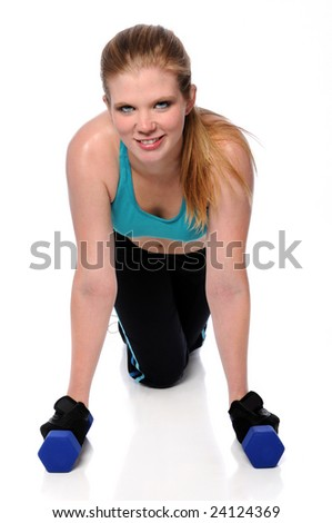 Woman working out with dumbbells isolated over a white background - stock photo
