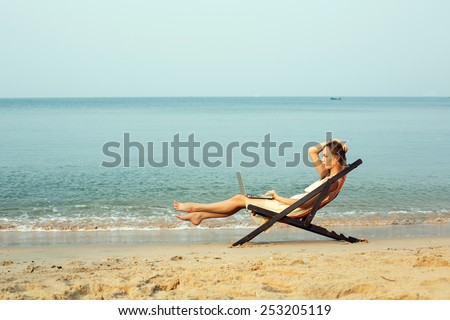 Woman working outdoors with laptop