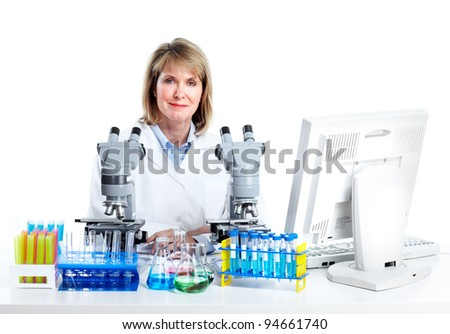 Woman working with a microscope in a laboratory. Isolated over white background - stock photo