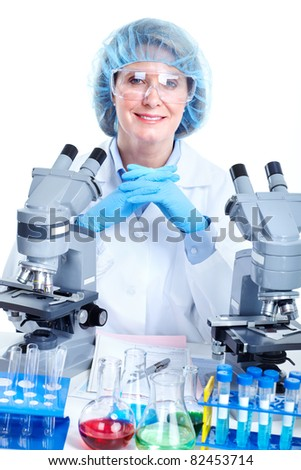 Woman working with a microscope in laboratory. Isolated over white background. - stock photo