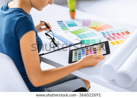 woman working with color samples for selection - stock photo