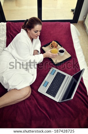 woman working with computer in her room quietly