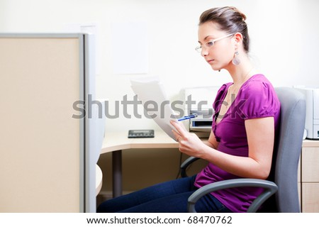 Woman working with docs at office in casual clothes - stock photo