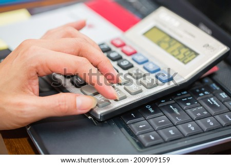 woman working with documents and calculator in the office
