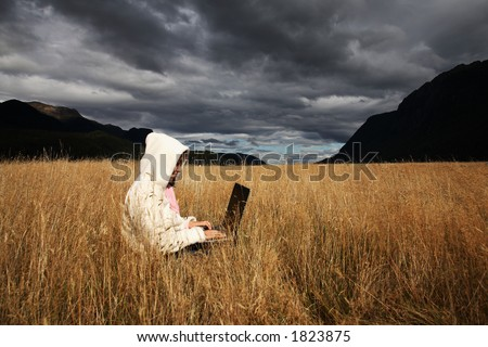 Woman working with laptop. - stock photo