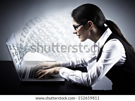 Woman working with laptop. Technology background. - stock photo