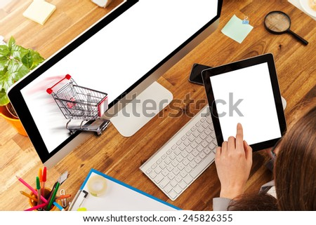 Woman working with pc placed on wooden desk. Concept of electronic shopping. Shot from aerial view - stock photo
