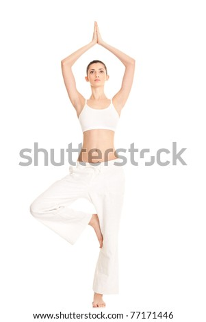 woman working  yoga exercise tree-pose, full-length portrait, isolated on white