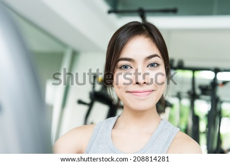 Woman workout at fitness gym - stock photo