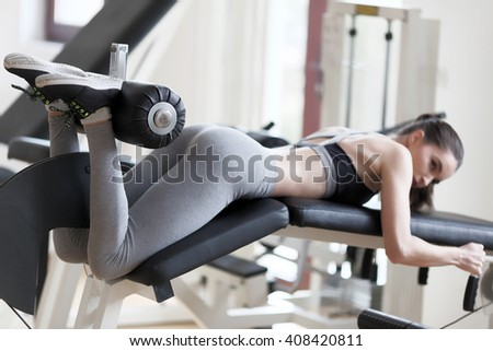 woman workout on machine in the gym - stock photo