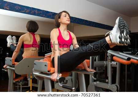 woman workout on machine in the gym