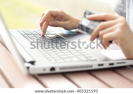 Woman works on computer.