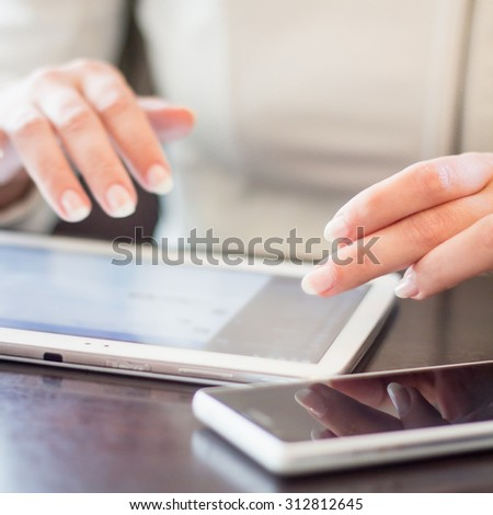 woman works on the digital tablet, soft focus, close up