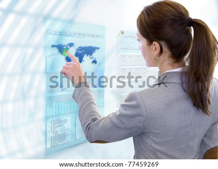 Woman works with future display - stock photo