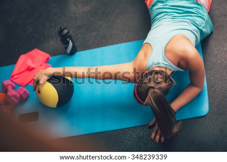 Woman worming up and stretching her body at the gym.Pilates. - stock photo