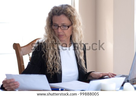 woman worried about bills and debt and foreclosure - stock photo
