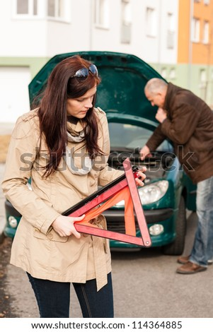 Woman worried about broken car warning sign breakdown crash problem - stock photo