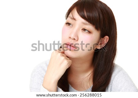 woman worries about something - stock photo