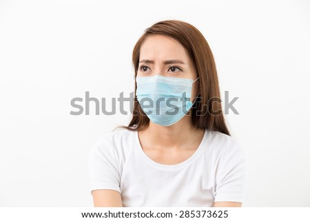 Woman worry about MERS - stock photo
