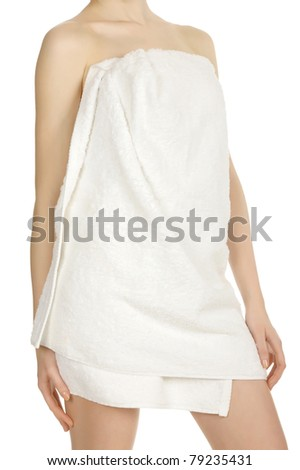 Woman wrapped in a towel posing on white background - stock photo